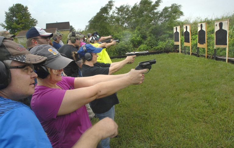Educators fire off rounds during a concealed carry class for teachers Sunday, June 10, 2018, at  Adventure Tactical Training in Farmer City, Illinois. The class was designed to help teachers feel less vulnerable in the wake of a number of recent school shootings across the country.  (David Proeber, The Pantagraph via AP)