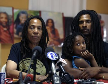 Debbie Africa, (left), participates in a news conference alongside her son Michael Africa, Jr. and granddaughter Alia, 6, Tuesday June 19, 2018, in Philadelphia. Africa, a member of the radical group MOVE, was released from prison on Saturday, nearly 40 years after the group engaged in a shootout that killed a Philadelphia police officer in 1978. Michael Africa, Sr., has now also been released.  (Jacqueline Larma/AP Photo)