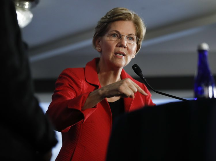 Sen. Elizabeth Warren, D-Mass., gestures while speaking at the National Press Club in Washington, Tuesday, Aug. 21, 2018. (Pablo Martinez Monsivais/AP Photo)