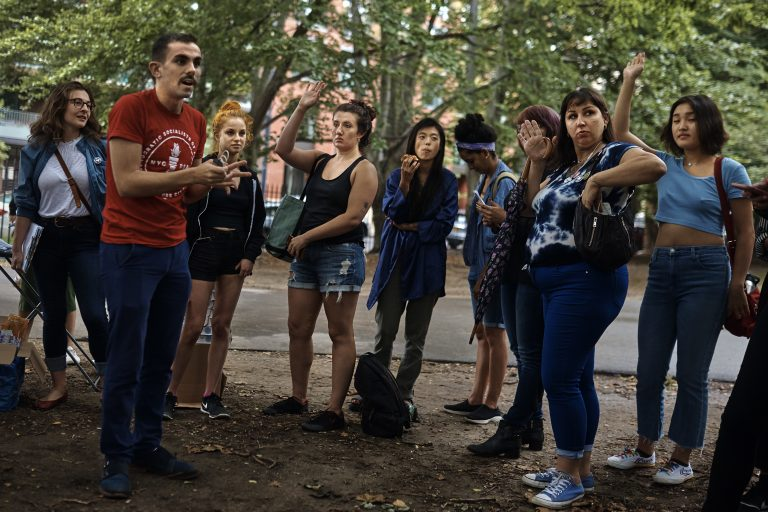 An organizer for the Democratic Socialists of America, second from left in red shirt, coaches sex workers and allies before they canvass for Julia Salazar, who is running for a seat in the New York State Senate. Salazar supports decriminalizing sex work and repealing laws that target people in the sex industry. (AP Photo/Andres Kudacki)