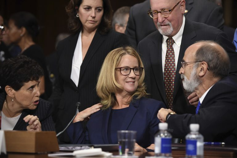 Christine Blasey Ford, the woman accusing Supreme Court nominee Brett Kavanaugh of sexually assaulting her at a party 36 years ago, chats with her attorneys as she testifies before the US Senate Judiciary Committee on Capitol Hill in Washington, DC, September 27, 2018. (Saul Loeb/Pool Photo via AP)