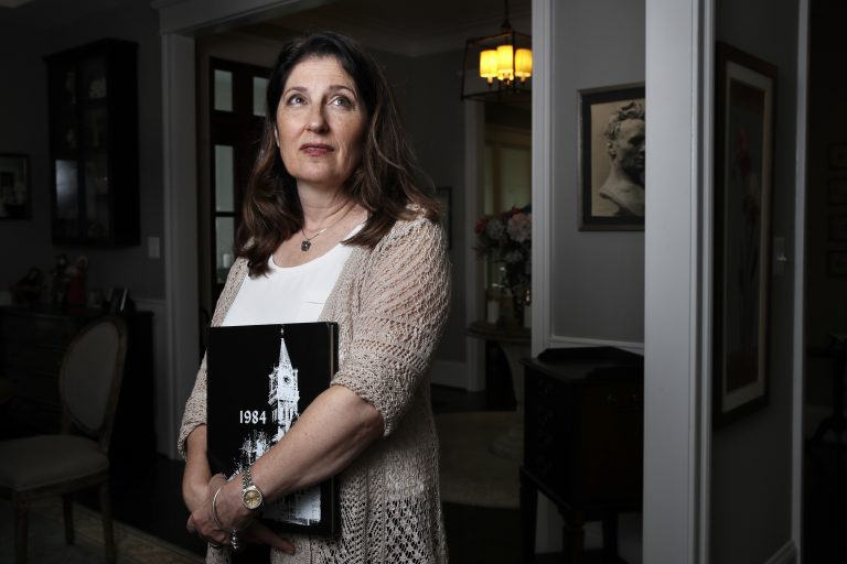 Ruth D'Eredita, poses for a portrait in her home in Vienna, Va., Friday, Oct. 5, 2018. D-Eredita graduated from Mount Holyoke College in 1984 and last October reported that a professor sexually assaulted her when she was a sophomore in college. Universities have seen an increase in decades-old sexual misconduct complaints amid the MeToo movement. (Jacquelyn Martin/AP Photo)
