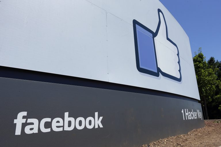 This July 16, 2013 file photo shows a sign at Facebook headquarters in Menlo Park, Calif.  (Ben Margot/AP Photo, File)