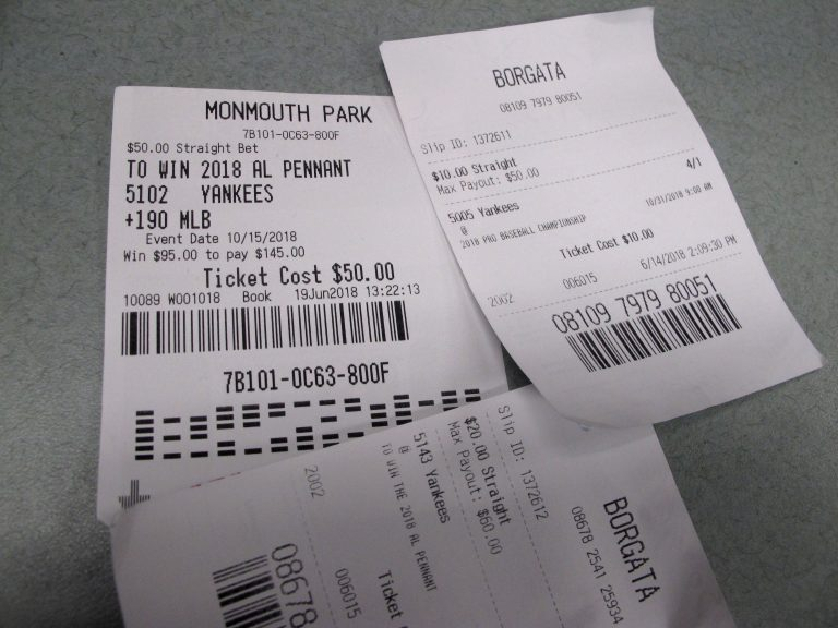 This Oct, 12, 2018 photo shows losing betting slips in Atlantic City, N.J. that had predicted the New York Yankees to either reach the World Series or win it. New Jersey gambling regulators were set to announce figures on Oct. 12 showing a