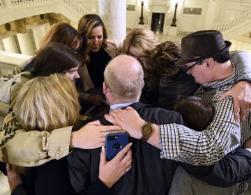 Survivors of child sexual abuse hug in the Pennsylvania Capitol while awaiting legislation to respond to a landmark state grand jury report on child sexual abuse in the Roman Catholic Church, Wednesday, in Harrisburg. (AP Photo/Marc Levy)
