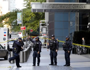 New York City Police Dept. officers arrive outside the Time Warner Center, in New York, Wednesday, Oct. 24, 2018. A police bomb squad was sent to CNN's offices in New York City and the newsroom was evacuated because of a suspicious package. (Richard Drew/AP Photo)