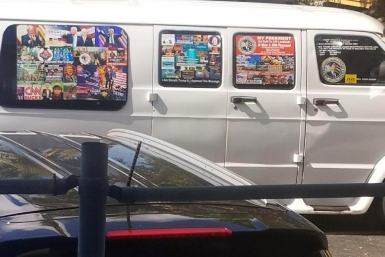 This Nov. 1, 2017, photo shows a van with windows covered with an assortment of stickers in Well, Fla. Federal authorities took Cesar Sayoc into custody on Friday, Oct. 26, 2018, and confiscated his van, which appears to be the same one, at an auto parts store in Plantation, Fla., in connection with the mail-bomb scare that has targeted prominent Democrats from coast to coast. (Courtesy of Lesley Abravanel via AP)
