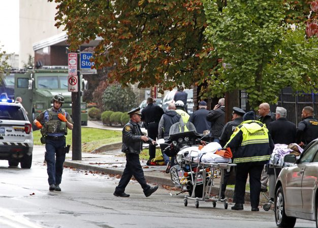 First responders surround the Tree of Life Synagogue, rear center, where a shooter opened fire Saturday, Oct. 27, 2018, wounding three police officers and causing