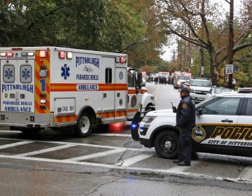 An ambulance arrives at the Tree of Life Synagogue where a shooter opened fire Saturday, Oct. 27, 2018. (Gene J. Puskar/AP Photo)