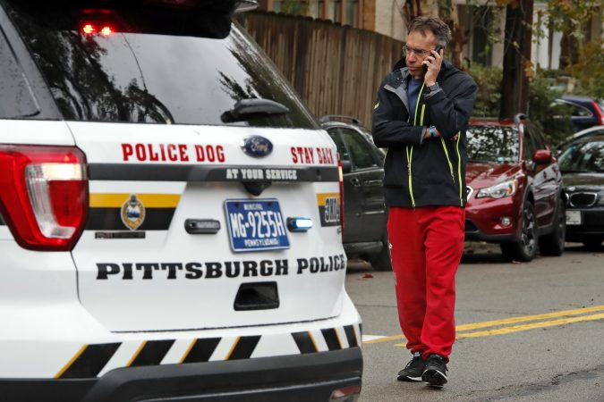 Michael Eisenberg, immediate past president of the Tree of Life Synagogue, talks to a reporter on the phone a few blocks from the Tree of Life Synagogue where a shooter opened fire Saturday, Oct. 27, 2018, injuring multiple people, including three police officers. (Gene J. Puskar/AP Photo)