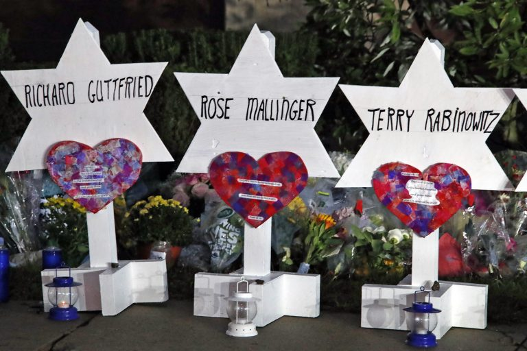 This photo shows some of Stars of David with names of those killed at the Tree of Life Synagogue in Pittsburgh in Saturday's shooting, at a memorial outside the synagogue. (AP Photo/Gene J. Puskar)
