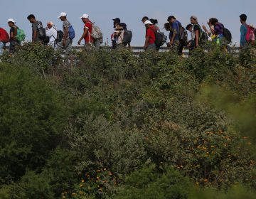 Migrants walk along the highway as part of a thousands-strong caravan of Central Americans continuing its slow journey toward the U.S. border, between Niltepec and Juchitan, Oaxaca state, Mexico, Tuesday, Oct. 30, 2018. (Rebecca Blackwell/AP Photo)