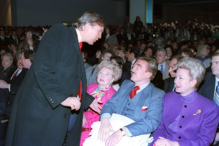 Donald Trump, left, talks with his parents, Mary and Fred and his sister, U.S. District Court Judge Maryanne Trump Barry, at the opening of Trump's Taj Mahal Casino Resort in Atlantic City, N.J., Thurs., April 5, 1990. (AP Photo)