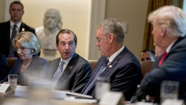 Health and Human Services Secretary Alex Azar, (center), accompanied by Education Secretary Betsy DeVos, (left), Interior Secretary Ryan Zinke, (right), and President Donald Trump, (right), speaks during a cabinet meeting in the Cabinet Room of the White House, Thursday, Aug. 16, 2018, in Washington. (Andrew Harnik/AP Photo)