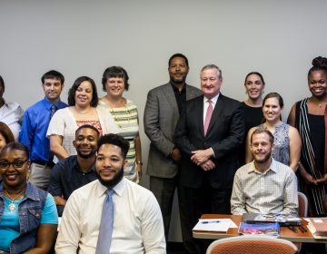Mayor Jim Kenney poses with staff from community schools. (Brad Larrison for WHYY, file)