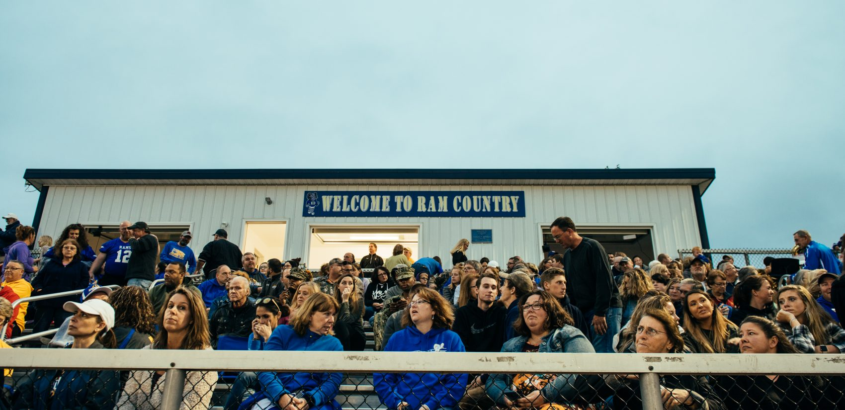 Parents waiting for the Kennard-Dale homecoming football game to start. (Dani Fresh for WHYY)