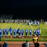 A player running the ball during the Kennard-Dale homecoming football game. (Dani Fresh for WHYY)