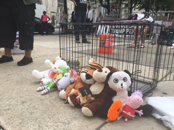 Anti-Trump protest by Refuse Fascism put a cage out with children's toys to symbolize the federal government's immigration policy that detained children (Taylor Allen/WHYY)