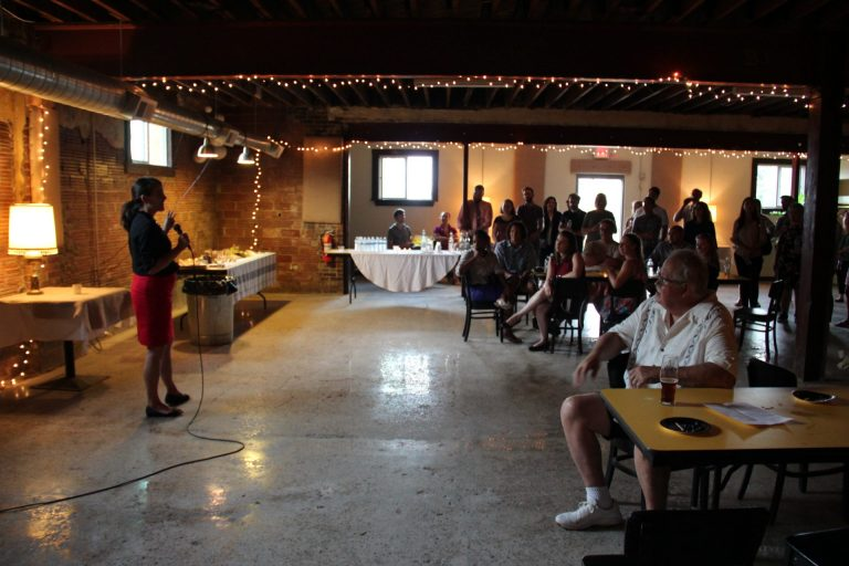 Elizabeth Fiedler, a candidate for state representative in Philadelphia, speaking at a fundraiser for DSA candidates in Pittsburgh. (Reid R. Frazier/StateImpact Pennsylvania)