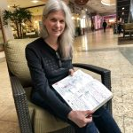 Macy's worker Susan Hedman keeps a notebook of all her schedule changes so she can hold Macy's accountable to Seattle's secure scheduling law. (Juliana Reyes)