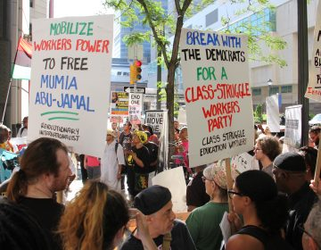 In August, demonstrators call for the release of Mumia Abu-Jamal who was convicted of killing a Philadelphia police officer in 1982. (Emma Lee/WHYY)