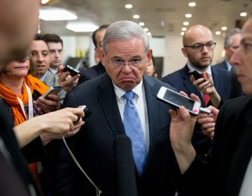 Sen. Bob Menendez, D-N.J., speaks with reporters on Capitol Hill in Washington, Tuesday, April 14, 2015. Menendez took a business-as-usual approach Monday when he returned to Congress for the first time since his April 1 indictment on federal corruption charges.
