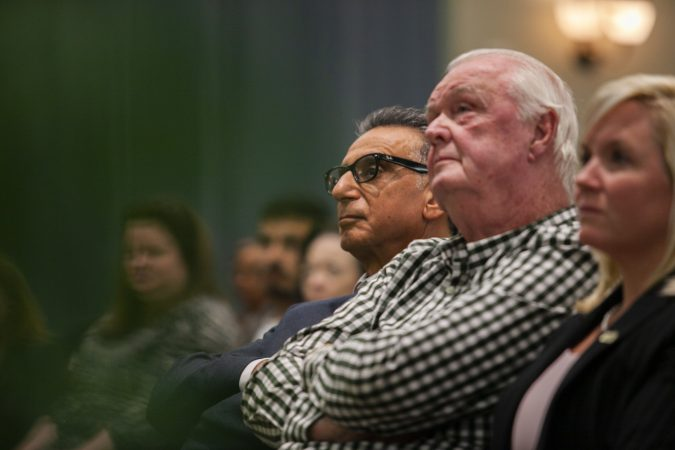 Glassboro, NJ - OCTOBER 18, 2018: Ali A. Houshmand, Rowan University president listen to former New Jersey Governor Chris Christie speak about the future of the Republican Party at an event at Rowan University. (Miguel Martinez for WHYY)