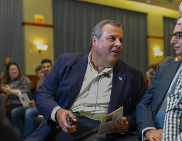 Former New Jersey Governor Chris Christie talks with Rowan University President Ali A. Houshmand during an event at the school titled