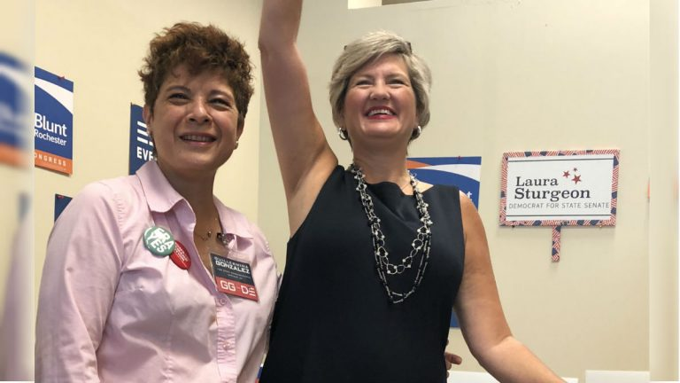 Guillermina Gonzalez (left) and Laura Sturgeon are running for the Delaware House and Senate, respectively. Both candidates participated in a September gun control rally in Hockessin. (Cris Barrish/WHYY)