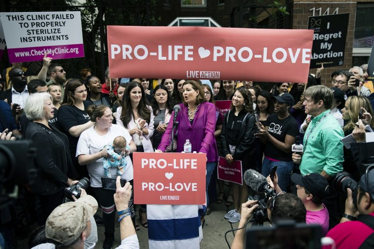 Ashley Garecht speaks as anti-abortion protesters rally near a Planned Parenthood clinic in Philadelphia, Friday, May 10, 2019. The demonstration was spurred by the actions of a Democratic state lawmaker who recorded himself berating an anti-abortion demonstrator at length outside the clinic. (Matt Rourke/AP Photo)
