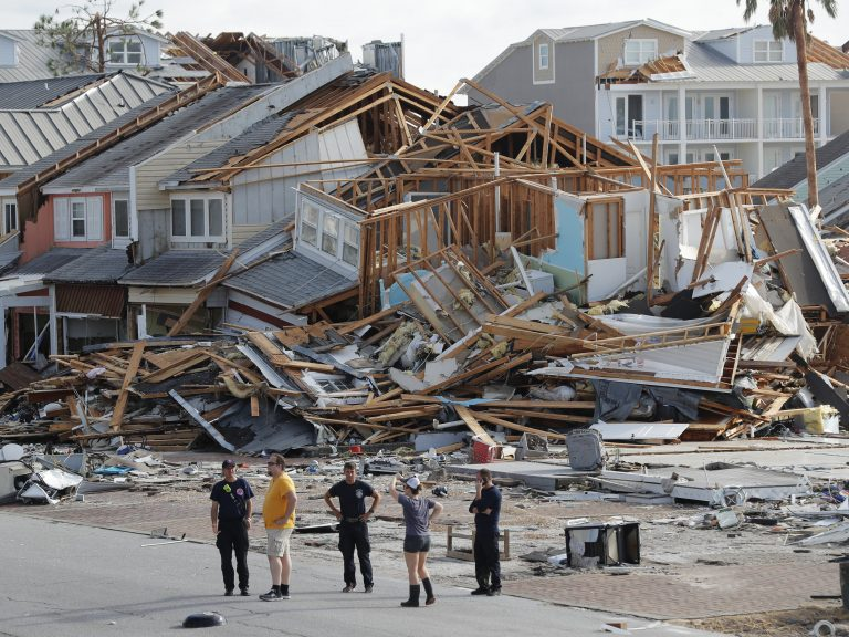 Rescue personnel search for people who may need help in Mexico Beach, Fla., on Thursday, one day after Hurricane Michael made landfall near the area. (Gerald Herbert/AP)