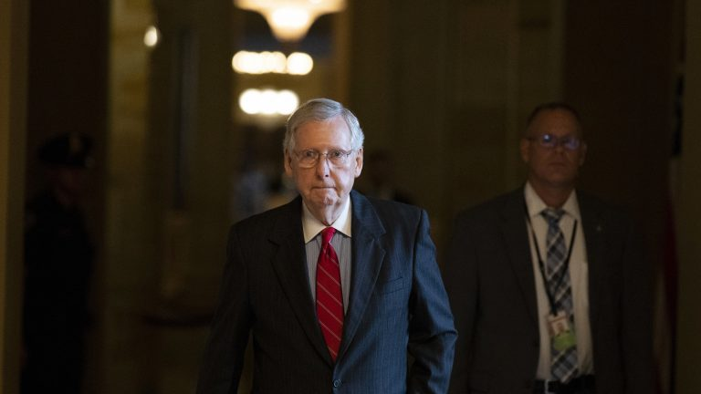 Senate Majority Leader Mitch McConnell of Kentucky walks to the Senate floor for a vote on Thursday. (Alex Brandon/AP)