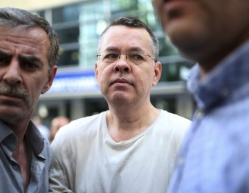 Andrew Brunson, seen here in July, arrives at his house flanked by Turkish officials in Izmir, Turkey. The newly freed U.S. pastor arrived Saturday on American soil, and he is meeting President Trump at the White House. (Emre Tazegul/AP)