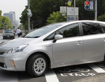 Toyota says it will use a software update to fix an issue with some Prius models, saying certain conditions could result in their unexpectedly stalling. Here, a Prius is seen during a test drive in Tokyo in 2011. (Koji Sasahara/AP)