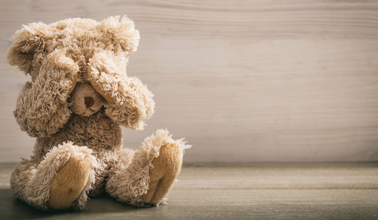 Teddy bear covering eyes. (Photo Courtesy/BigStock)