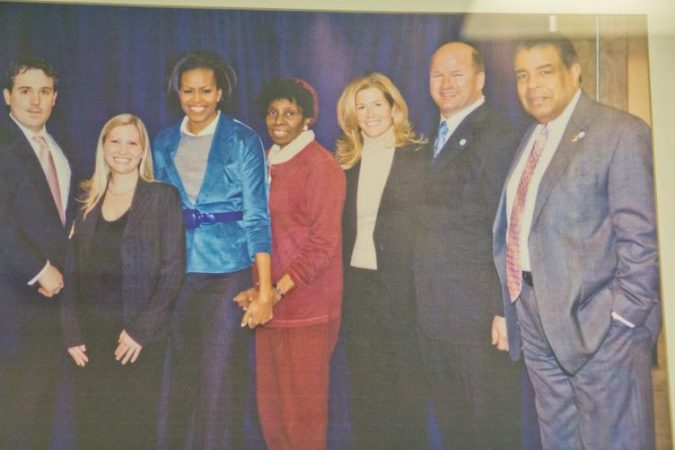 Board Chairman Emeritus Wendell Whitlock (far right) with others and Former First Lady Michelle Obama when she visited Sullivan Progress Plaza (Kimberly Paynter/WHYY)