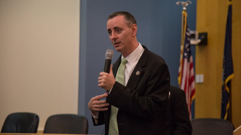 US Rep. Brian Fitzpatrick of Pennsylvania's 8th district talks to a crowd of constituents during a town hall in Bensalem, PA August 22nd 2017. (Emily Cohen for NewsWorks)