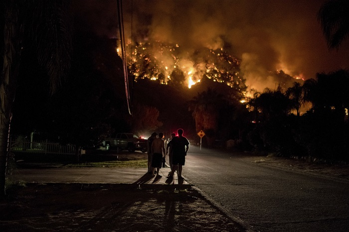 Residents watch as the 18,137 acre Holy Fire burns around them for the fourth day in Lake Elsinore, California in the early morning on August 10, 2018. (Photo by Christian Monterrosa / Sipa USA)(Sipa via AP Images)
