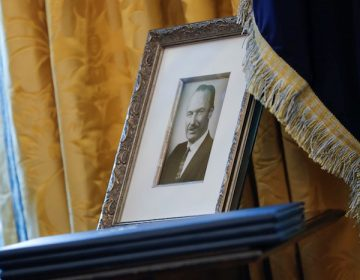 A photograph of Fred Trump on display in the Oval Office.