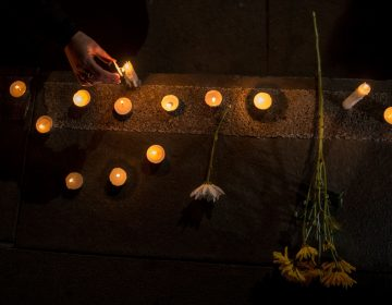 Chilean demonstrators light candles during an August vigil in Santiago that protested the sex abuse scandal roiling the Catholic Church. (Martin Bernetti/AFP/Getty Images)