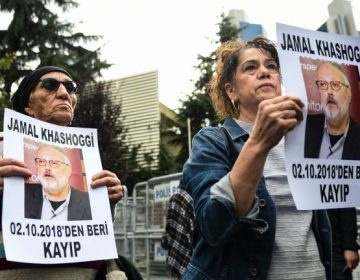Protestors hold portraits of missing journalist Jamal Khashoggi outside Saudi Arabia's consulate in Istanbul. Khoshoggi disappeared upon visiting the consulate two weeks ago. (Bulent Kilic/AFP/Getty Images)