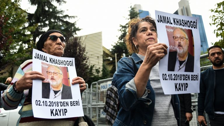 Protestors hold portraits of missing journalist Jamal Khashoggi outside Saudi Arabia's consulate in Istanbul on Tuesday. Khoshoggi disappeared upon visiting the consulate last week. (Bulent Kilic/AFP/Getty Images)