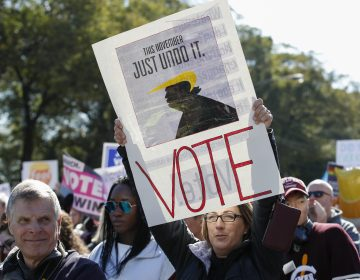 Women gather for a rally and march at Grant Park on Saturday in Chicago to urge voter turnout ahead of the midterm elections. (Kamil Krzaczynski/AFP/Getty Images)