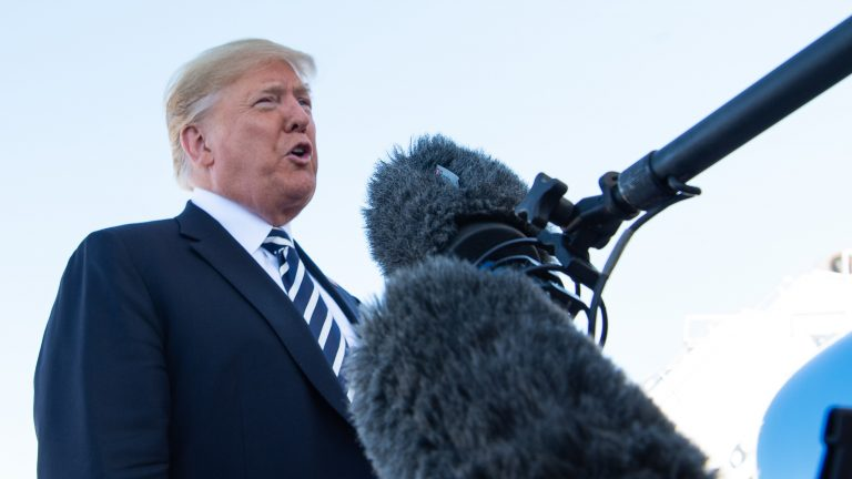President Trump speaks to reporters before boarding Air Force One in Elko, Nev., Saturday. He said the U.S. would withdraw from a nuclear arms treaty with Russia and accused Russia of violating it. (Nicholas Kamm/AFP/Getty Images)