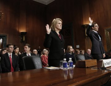 Appellate court nominees Bridget S. Bade and Eric D. Miller are sworn in during a hearing held by the Senate Judiciary Committee on Wednesday. Only two senators — Mike Crapo, R-Idaho, and Orrin Hatch, R-Utah — were in attendance. (Win McNamee/Getty Images)