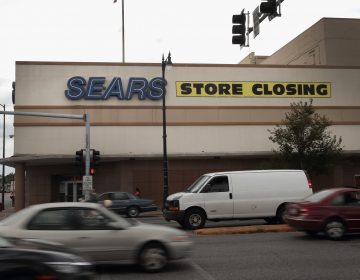 A sign announcing a storeclosinghangs above a Sears in Chicago. The bankruptcy filing could mark the end of the struggling retailer, which invented the mail-order catalog busines