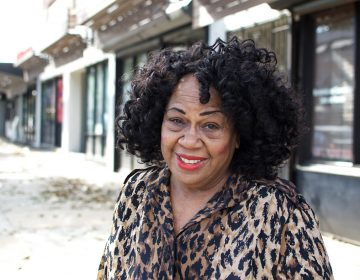 Shirley Armstead poses in front her E. Vernon Road storefront office. (Bastiaan Slabbers for PlanPhilly)