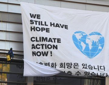Greenpeace activists hang a banner prior to a press conference of the Intergovernmental Panel for Climate Change (IPCC) in Incheon, South Korea. The landmark U.N. report on limiting global warming to 1.5 degrees Celsius was released after a week-long meeting of the IPCC's 195 member nations.
