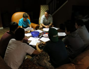 Cody Greenes (center), 35, group leader with the Jewish organization Moving Traditions, leads six high school freshman boys in a discussion about sexual assault and consent.