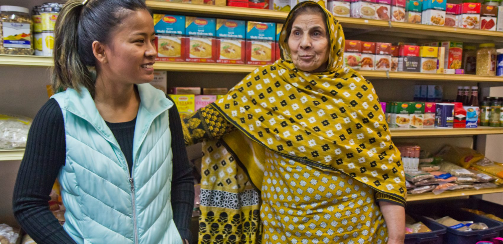 Somaly Osteen (left) won the Instigator Award for her work on the South 7th Street commercial corridor. Irshad Aslam (right) has owned the Aslam Market since 1986. (Kimberly Paynter/WHYY)